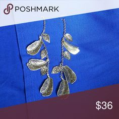 Artisan Sterling Silver Feather Earrings These earrings are very pretty. They are made of sterling silver and have some weight to them. They are feather shaped, for pierced ears. Made by Hand Jewelry Earrings