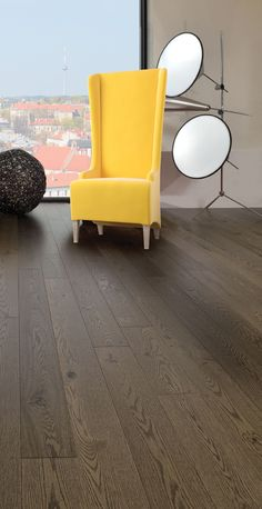 Mirage Floors, the world's finest and best hardwood floors. Imagine Collection - Old Red Oak Sandstone #redoak #sandstone #floor #hardwood #mirage #chair