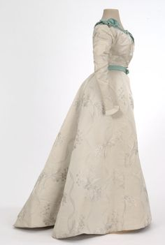 Pearl gray brocade satin dress,  Mrs. George F. Hall, St. Paul, MN, 1897-99. Worn by Rebecca Blair Flandrau.