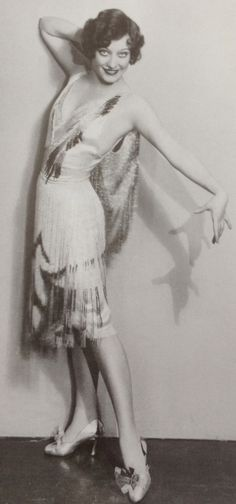Oh, I desperately want to make a copy of this dress that Joan Crawford wears in Our Dancing Daughters!