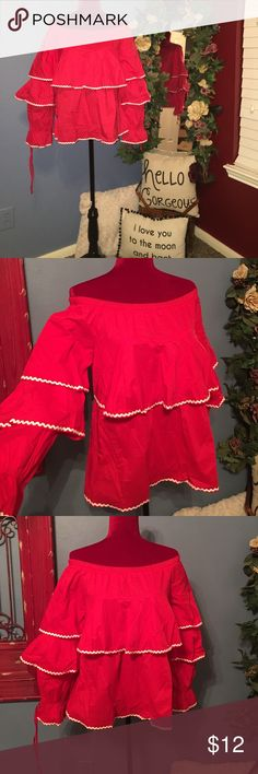 💄💋❤Absolutely adorable red ruffle top❤️💋💄NWT Reposhing an adorable red ruffle top with white lining the ruffles! Unfortunately it doesn't fit me like it should!! 100% Rayon size medium! 😍😍😍 New with tags! Pastels Clothing Tops