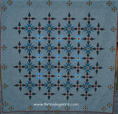 """Spotlight on the Stars"" ~ designed & pieced by Dan Perkins, quilted by Carol Perkins"