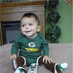 such a cute football outfit!-- i will have a little cheese head one day!