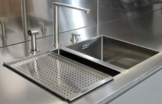 Single Barazza stainless steel worktop  with welded hob and sink area.