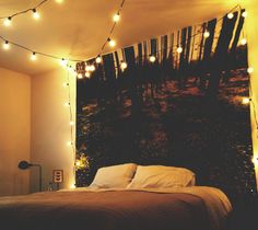 Moonbeam tapestry from urban outfitters and some indoor/outdoor globe lights make for a magical bedroom ambiance.