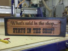 What's said in the shop sign  2.5D carved cedar