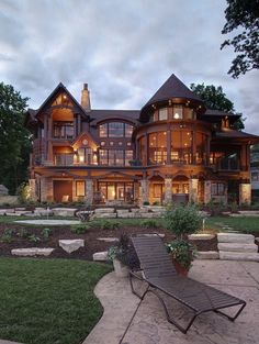 It's a little traditional for my taste but I just love all the windows. I can only imagine how bright it is in the daytime! Bonus points for great outdoor lightscaping.