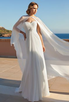 Brides: Demetrios - Destination Romance . Chiffon, strapless, A-line gown with a sweetheart neckline and ruched, wrap bodice with beaded brooch. Gown features a sweep train.