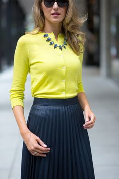yellow cardigan, navy pleated skirt & statement necklace