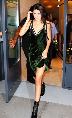 For all those in need of Saturday night outfit inspiration, look no further than Vogue cover girl Kendall Jenner in an emerald green velvet slip dress. Styling tip: add a focal point to your slip via a harness-strap bra.