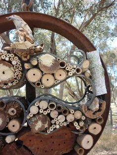 Joanne Diver Life Bee Inn It Habitat for: Solitary Australian Native Bees including, Blue-banded bee, Reed Bee, Resin Bee and Leafcutter Bee. Diameter 53 cm Found, recycled and salvaged materials, included a rusted wheel rim, wrought iron frame, timber and organic materials including silver birch, bamboo, lemon-scented gum, red-gum, yellow-box, grass tree flower spike and soft mortar mix. Image: Joanne Diver