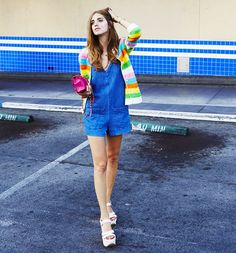 Chiara Ferragni wears a denim romper, striped jacket, pink Chanel bag, and platform sandals
