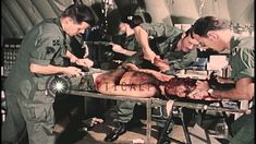 Doctors and Nurse in Vietnam treat a severely wounded United States soldier