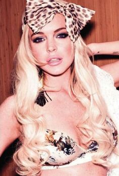 Lindsay Lohan will always rock to me. she is an icon to the fullest! fun and sexxxy! i googled lindsay lohan and each picture she has a different hair color and looks awesome, i love her!