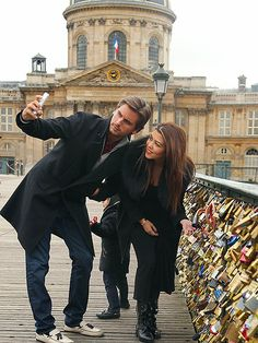 Kourtney Kardashian and Scott Disick in Paris (on the bridge with the locks)
