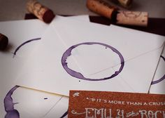 envelopes sealed with a wine glass stain - great inspiration for a wine country or themed event