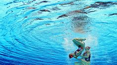 Team work: Russians Natalia Ischenko and Svetlana Romashina in the women's Duets Synchronised Swimming Free Routine preliminary. #Olympics