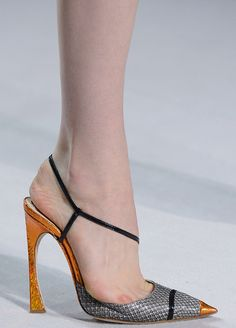 Christian Dior SS13...HER FOOT ISNT EVEN IN THE SHOE..ITS STEPPING ON THE EDGE AND LOOK AT HOW DAMAGED HER TOE IS...GEE WHIZ !