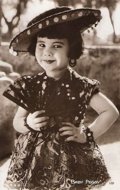 https://flic.kr/p/RiC2PF | Baby Peggy | French postcard by Cinémagazine-Edition, Paris, no. 161.  Diana Serra Cary (1918), best known as Baby Peggy, was one of the three major American child stars of the Hollywood silent movie era along with Jackie Coogan and Baby Marie. The first film, Playmates in 1921, was a success, and Peggy was signed to a long-term contract with Century Studios. Between 1921 and 1923 she made over 150 short comedies for Century. In 1922 she received 1.2 million fan…