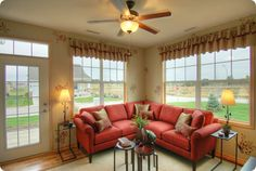 Red sectional living room with large windows