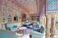 Samode Palace Hotel, India. A veranda off the central courtyard. Many of the hotel's spaces feature lavish frescoes and colorful fabrics from Jaipur.