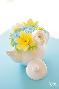 Just listed this wonderful, Spring inspired mini teapot design.