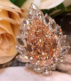 Breathtaking fancy brownish pink pear-shaped diamond in a halo of rose-cut diamonds from Novel's Collection of rare fancy color diamonds Pink Jewelry, Luxury Jewelry, Diamond Jewelry, Jewelery, Jewelry Accessories, Jewelry Design, Sapphire Diamond Engagement, Pear Shaped Diamond, Rose Cut Diamond