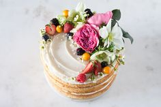 It's like a summer cornucopia for your wedding cake! The mix of fresh flowers and fresh fruit looks like they've just been picked fresh off the vine, though the artful arrangement suggests otherwise. This look is especially perfect for those warm weather weddings when blooms are abundant and the outdoors are full of life and vibrant color.