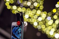 https://flic.kr/p/qQs2hM | 20150209_F0001: A mobile bokeh shooter | - This is an iPhone 5s with a Gizmon Smart Clip fisheye lens attached. It looks like the lens is shooting out bokeh octagon lights from this angle.