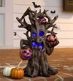 Prop this color-changing Lighted Spooky Tree Halloween Decoration on a mantel, on your stoop or on a table for a delightful yet ominous treat. The color-changing LEDs illuminates the tree's face and his three scary jack-o'-lanterns. Halloween Prop, Halloween Party Supplies, Halloween Village, Halloween Trees, Outdoor Halloween, Halloween Pumpkins, Fall Halloween, Halloween Crafts, Halloween Decorations