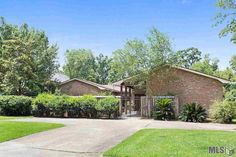 RARE FIND! THIS CUSTOM HOME WITH A VIEW OF THE LSU LAKES, HAS A BEAUTIFUL GUEST HOUSE AND IS ON APPROXIMATELY AN ACRE OF LAND. THIS 4 BEDROOM HOME IS UNIQUE AND HAS A WONDERFUL FLOOR PLAN.  10 AND 12 FT. CEILINGS.  THE KITCHEN WAS RECENTLY UPDATED WITH GRANITE COUNTER-TOPS, A GAS COOK-TOP, HAS AN EAT IN BAR AND A LARGE FORMAL DINING ROOM. THE LIVING ROOM HAS A WET BAR WITH AN ANTIQUE MANTEL AND BRASS FOOT RAIL WITH LARGE GLASS DOORS OVERLOOKING THE LOVELY COURTYARD. THE DEN IS HUGE WITH…