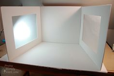 Make your own light studio using tracing paper, foam board and a roll of white paper. Easily folds away for flat storage. Plus, how to get natural light with lamps.