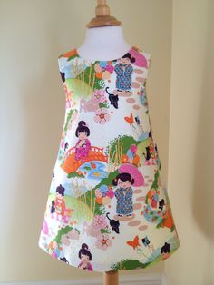 Girls dress, versatile pinafore in a stunning fabric, made by me. To see more of my dresses visit my Etsy page, LilyrhodesUK