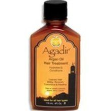 OK, not homemade, BUT, it is a good natural remedy to the frizz! Agadir Argan Oil Hair Treatment