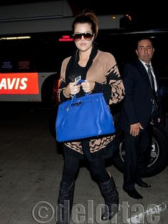 Khloe Kardashian was spotted today departing LAX airport toting a yummy electric blue Hermes Birkin.    *courtesy of www.facebook.com/DelortaeAgency UK's principal luxury authentic handbag SPA