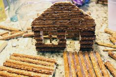 Great instructions on how to make a pretzel log cabin.  My craft project for the week after finals.