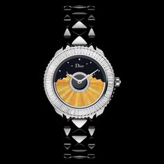 """Dior VIII Grand Bal modèle 'Plissé'Ø 38 mm, automatic movement """"Dior Inversé"""" calibre, oscillating weight in Wollo opal marquetry and diamonds, black high-tech ceramic and white gold case and bracelet, bezel set with baguette diamonds, crown set with a diamond, black mother-of-pearl dial set with diamonds, anti-reflective sapphire crystal glass, translucent black case-back. Discover more on www.dior.com"""