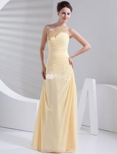 Gorgeous Daffodil Chiffon One Shoulder Prom Dress. This gorgeous gown is just perfect for any would-be prom queen. Its made in a sheath style with one shoulder strap and an elegant ruched pattern in the bodice. The front strap turns into skinny ribbon straps in the back.. . See More One Shoulder at http://www.ourgreatshop.com/One-Shoulder-C935.aspx