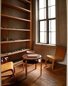 The corner library the Judd House in New York, the former home and studio of the artist Donald Judd: Cantilever birch plywood chairs model No.31 (1935) and round table model No.70/8-3 (c.1930s) all by Alvar Aalto, Finland....