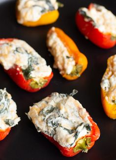 Spinach and Cheese Stuffed Peppers are a super easy party pleaser. No need to worry about spice these easy stuffed peppers use sweet peppers cream cheese and spinach to create awesome finger food great for any occasion. Cream Cheese Stuffed Peppers, Cream Cheese Spinach, Vegetarian Stuffed Peppers, Easy Stuffed Peppers, Cream Cheese Recipes, Veggie Recipes, Appetizer Recipes, Keto Recipes, Vegetable Appetizers