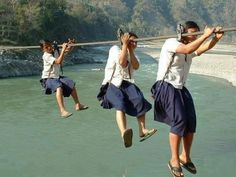 Girls on the way to school in remote Nepal.There is no bridge and they have to daily risk their lives for education. No photo credit available.