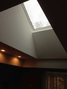 Skylight ideas to make your space brighter elegant view of skylight up close both ends were flared to make the opening Skylight Covering, Skylight Shade, Skylight Blinds, Skylight Design, Skylight Window, Stairs Window, Roof Window, Skylights, Skylight Bedroom