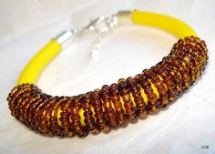 Bracelet on rubber cord yellow the spiral of small 2 by OGEjewelry