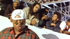 A still from the video for E-40s 1993 song Practice Looking Hard, in which rappers like The Coups Boots Riley (second from right) and Tupac (not pictured) also appeared. The Many Sounds of 1993 Bay Area Rap NPR