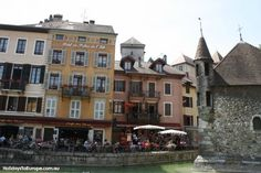 Cafes and restaurants line the canals of the medieval quarter of Annecy.