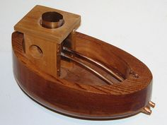 """DIY steam boat bath toy (6""""). Light a small lamp of olive oil and away it goes!"""