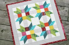 Mini Quilt with Colorful Poinsettia Design - http://www.craftsy.com