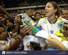 Leila Barros of Brazil signs autographs for fans after receiving the Most Popular Player Award at the Manila leg of the World Grand Prix volleyball tournament in Manila, Philippines on Sunday, 18 July 2004