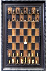 """Straight Up Chess - Hangs on the wall like Art and you play a casual game of chess as you pass by. Make your move, mark it with the """"last Move"""" marker and go on your way. Fun and decor for any Man Cave, Game Room, Hallway to Professional Office. Shown here is the Burnt Chess pieces on Black Walnut board with Traditional Brown frame. Straightupchess.com"""