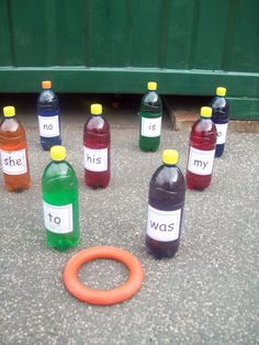 Reading - HFW Ring Around A Bottle - students toss the ring and say the word if they land on one